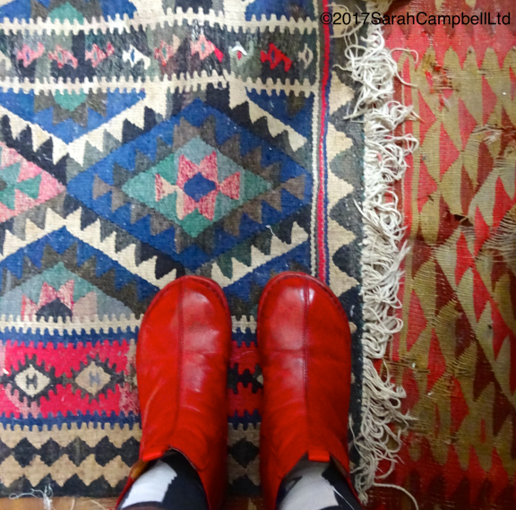 shiny-red-boots-on-the-carpets