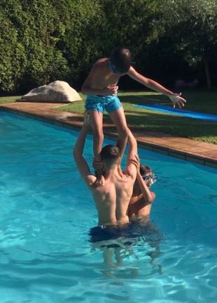 boys in pool, spain